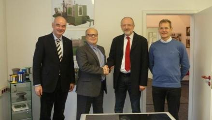 The picture shows the following persons (left to right): Dr. Detlef Schildbach (Managing Director / Owner of Elektrisola = Parent company of Schmidt)